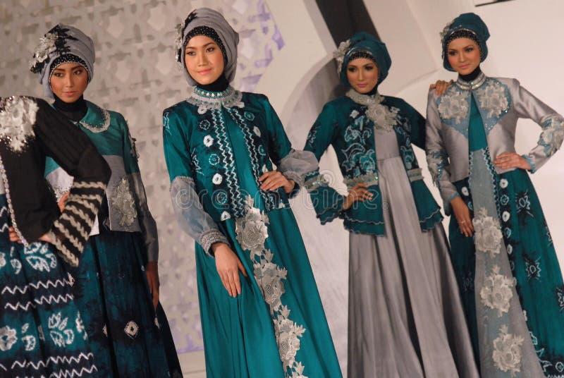 Muslim Fashion Festival 2014. Models showcase designs by Lilik Suhariyati on the runway at the 5th Muslims Fashion Festival 2014 show on October 3, 2014 in royalty free stock image