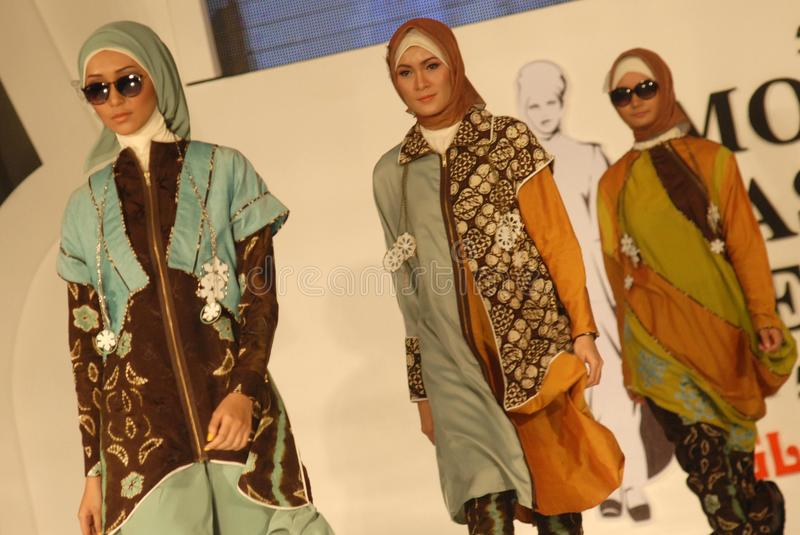 Muslim Fashion Festival 2014. Models showcase designs by Lita Berlianti on the runway at the 5th Muslims Fashion Festival 2014 show on October 3, 2014 in royalty free stock image
