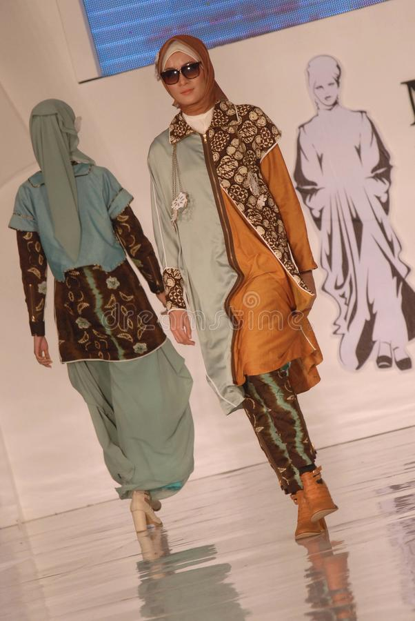 Muslim Fashion Festival 2014. Models showcase designs by Lita Berlianti on the runway at the 5th Muslims Fashion Festival 2014 show on October 3, 2014 in stock image