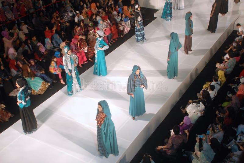Muslim Fashion Festival 2014. Models walk on the runway at the 5th Muslims Fashion Festival 2014 show on October 3, 2014 in Surabaya, Indonesia. 5th Muslims royalty free stock photo