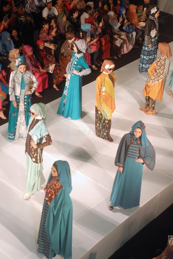 Muslim Fashion Festival 2014. Models walk on the runway at the 5th Muslims Fashion Festival 2014 show on October 3, 2014 in Surabaya, Indonesia. 5th Muslims stock photo