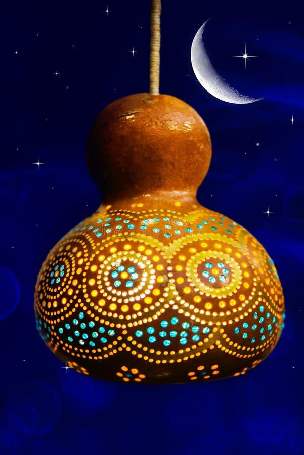 Islamic arabic ornament. The Muslim Feast of the Holy Month of Ramazan Kareem Beautiful Premise with a Shining Flashlight royalty free stock photography