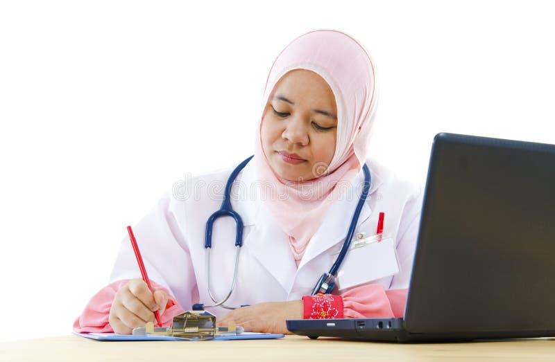 Muslim female doctor stock image
