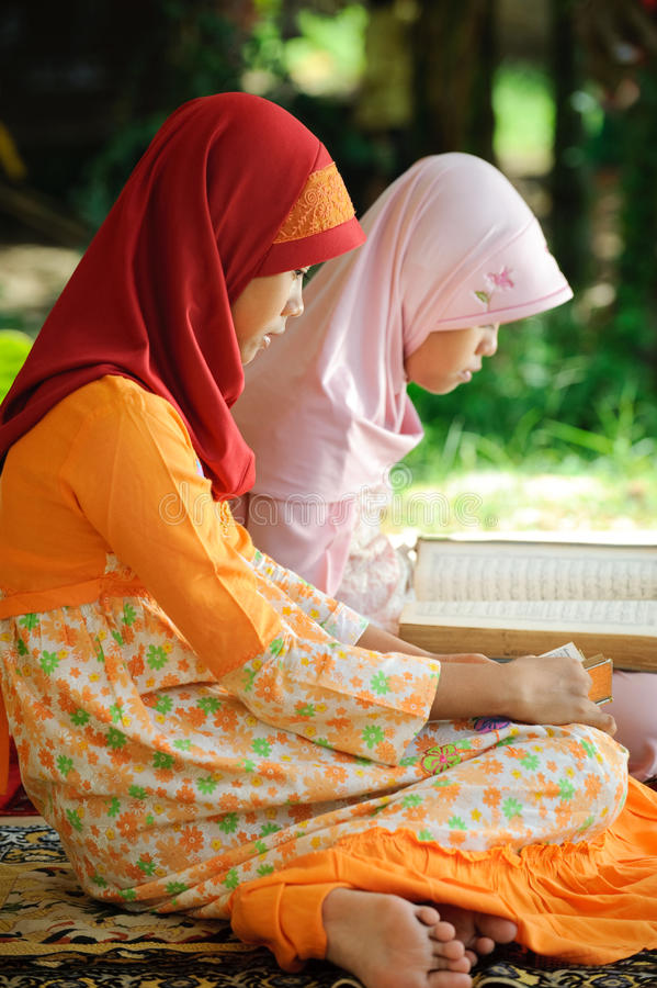 Muslim Female Reading Koran Royalty Free Stock Photography