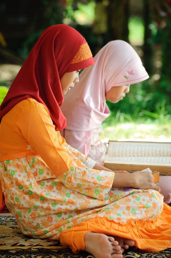 Muslim Female Reading Koran royalty free stock photography