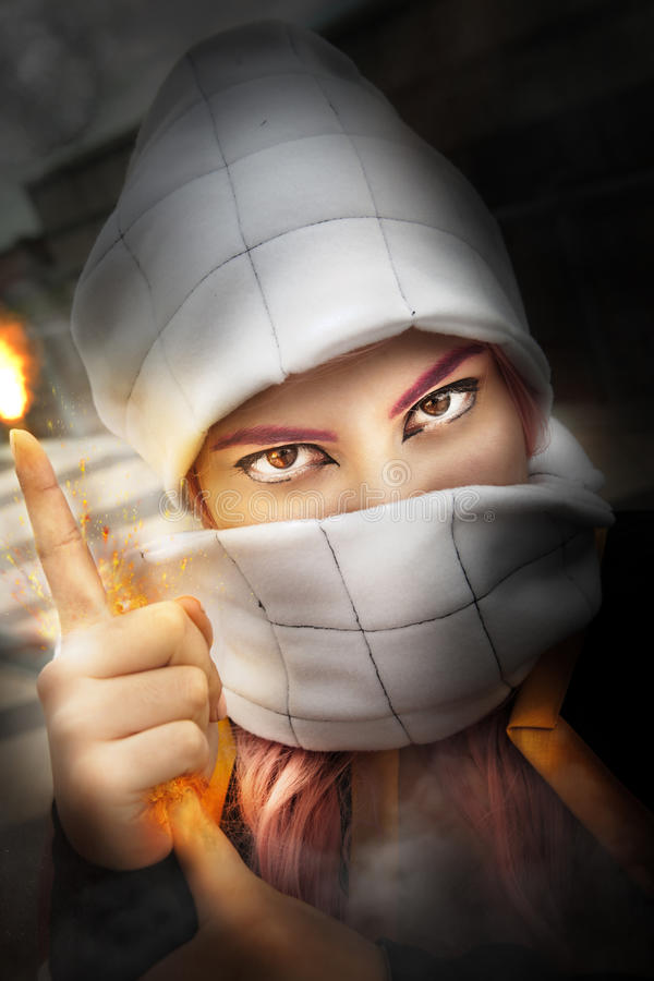 Muslim fire in hand. Cosplayer. Woman with her face covered stock photography
