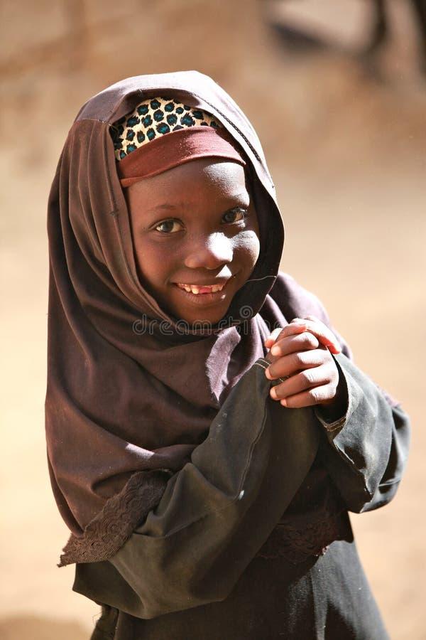 Muslim girl in Africa. Smiling young moslima girl in Africa before the start of koran school