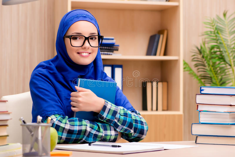 The muslim girl preparing for entry exams. Muslim girl preparing for entry exams royalty free stock photos