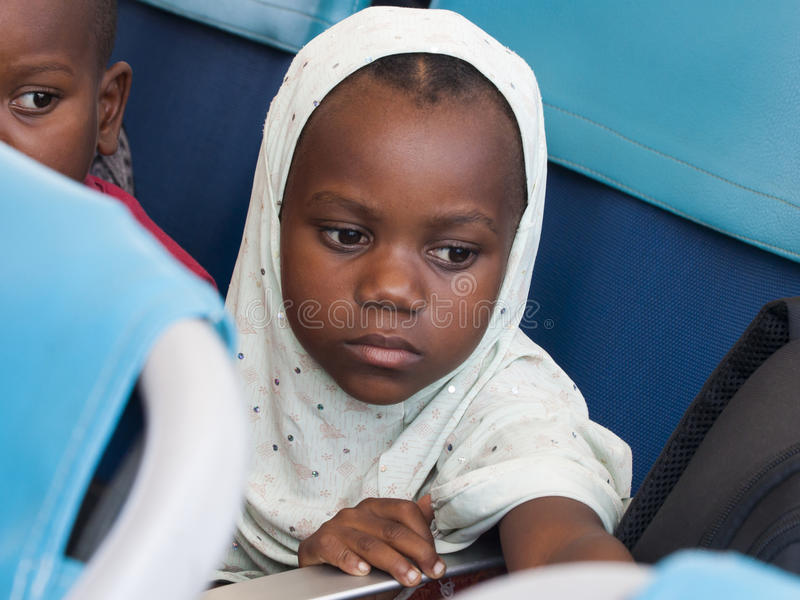 Muslim girl with a white veil, Tanzania royalty free stock image