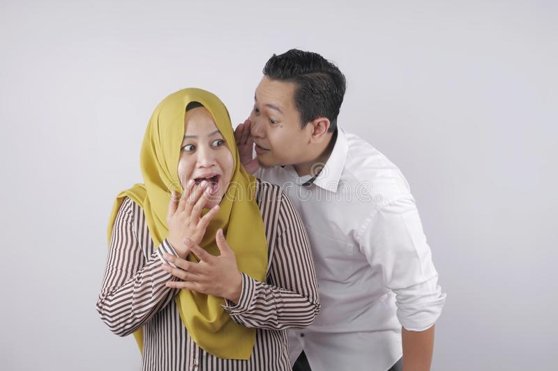 Muslim Husband Whispering Secret To Wife stock photography