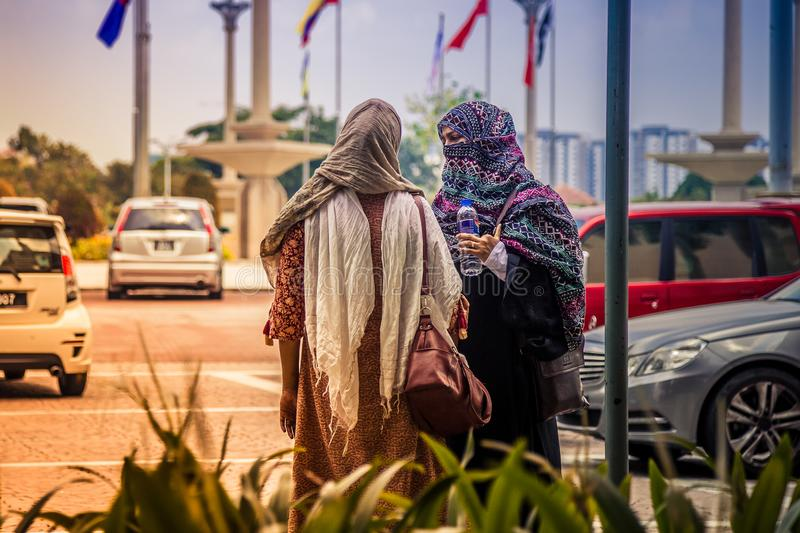 Muslim with islam costume after pray at Putra Mosque stock photography