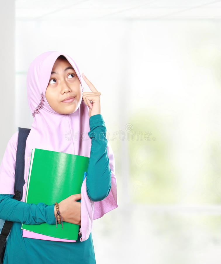 Muslim kid student thinking stock photo
