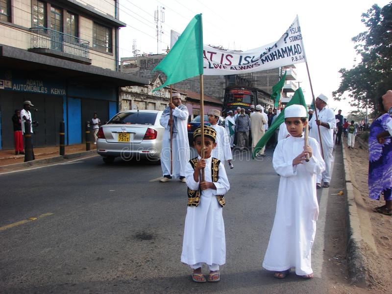 Muslim kids holding flag stock photo