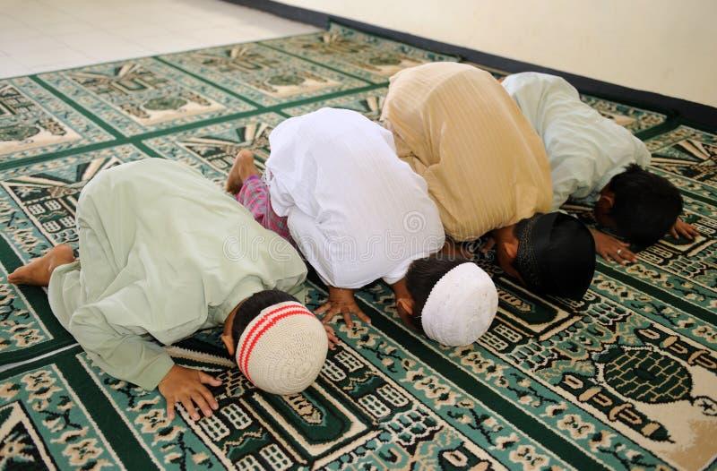 Muslim Kids Praying royalty free stock photos