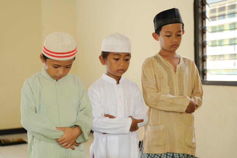 Muslim Kids Praying royalty free stock photography