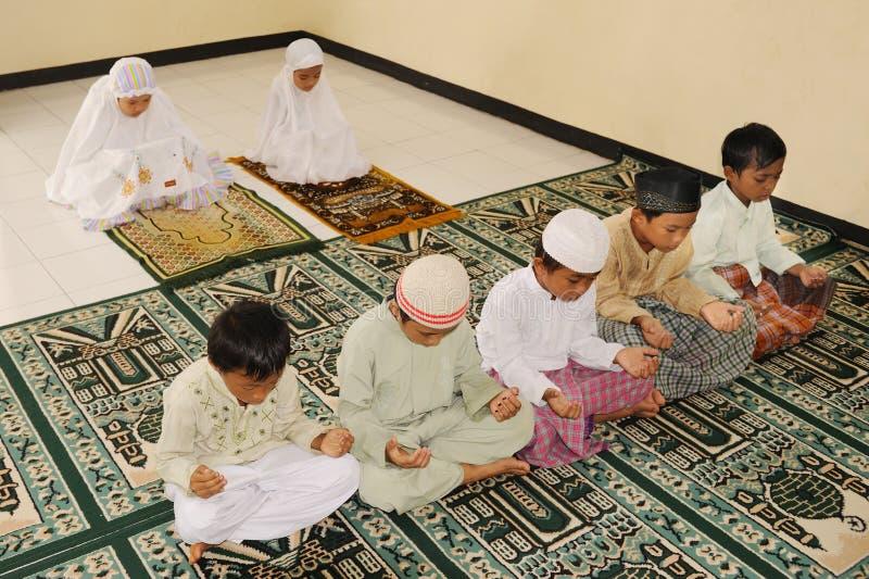Muslim Kids Praying stock photos