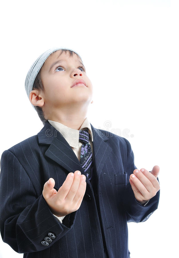 Muslim little cute kid praying, isolated stock images