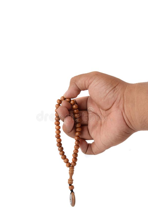 Muslim male hands holding rosary stock photography