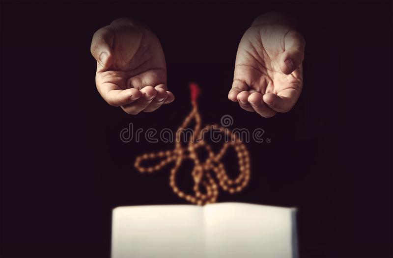 Muslim man hands holding rosary royalty free stock photography