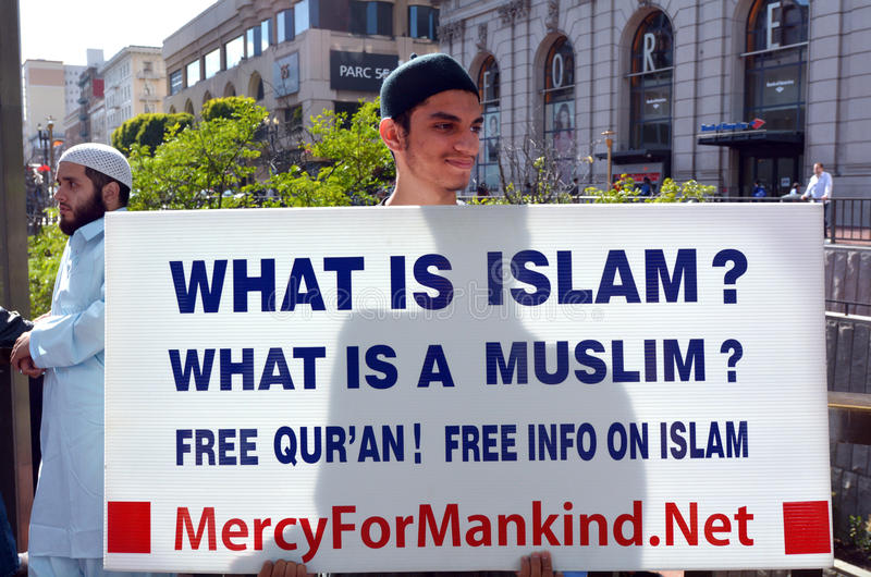 Muslim man holds a What is Islam sign during a protest. SAN FRANCISCO - MAY 17 2015:Muslim man holds What is Islam sign during a protest. New reports show that royalty free stock photography