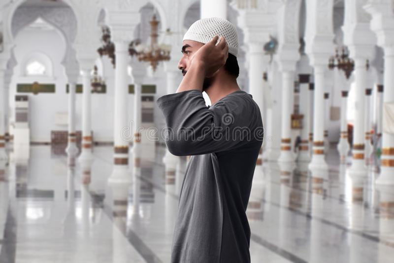 Muslim man praying in mosque royalty free stock photos