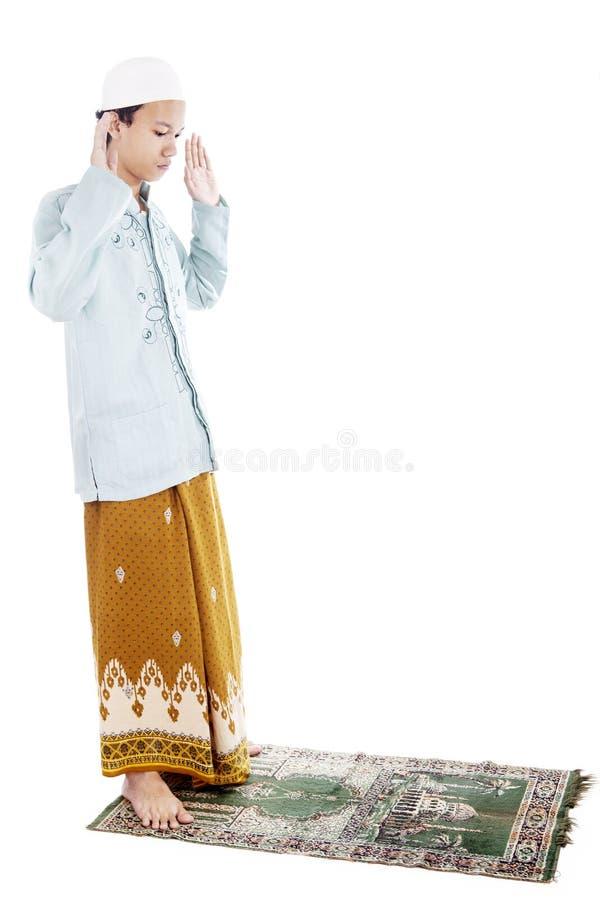 Muslim Man Praying On Mat Stock Photo