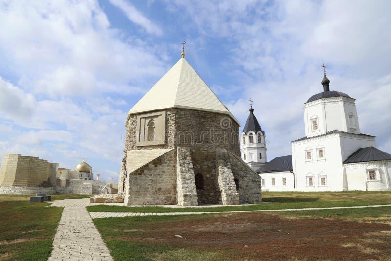 Muslim mausoleum and Orthodox church, Bulgar, Russia. Monuments of XIII century in Bolgar archaeological site. East muslim mausoleum and Orthodox church stock photos