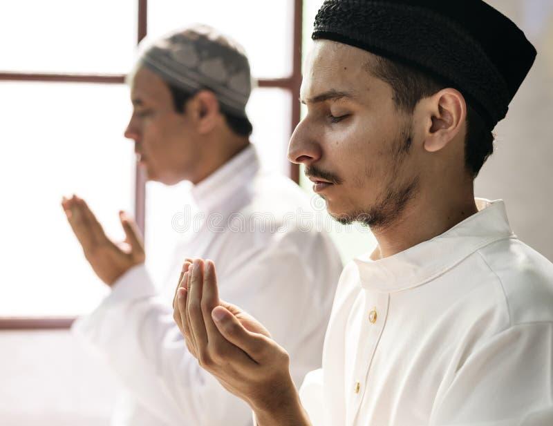 Muslim men praying during Ramadan stock image