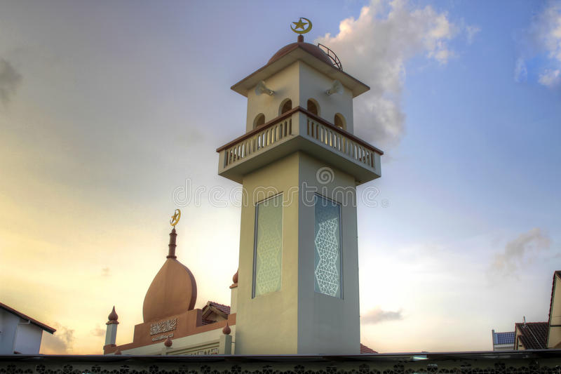 Muslim Mosque in Singapore. Muslim Mosque Temple in Singapore against Sunset Sky stock photography