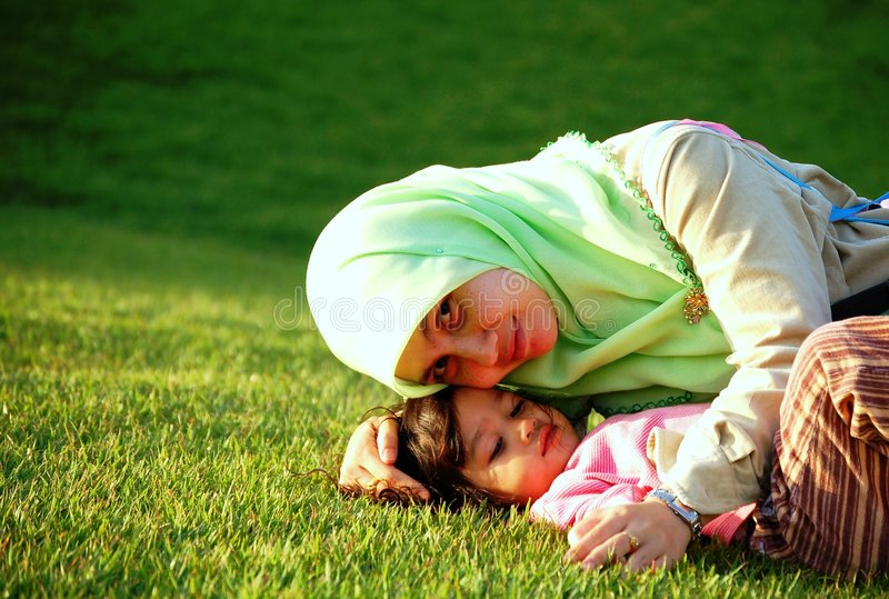 A Muslim Mother and Daughter stock photos