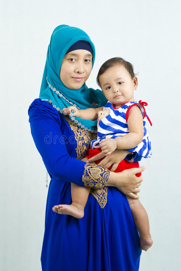 Muslim mother and daughter stock images