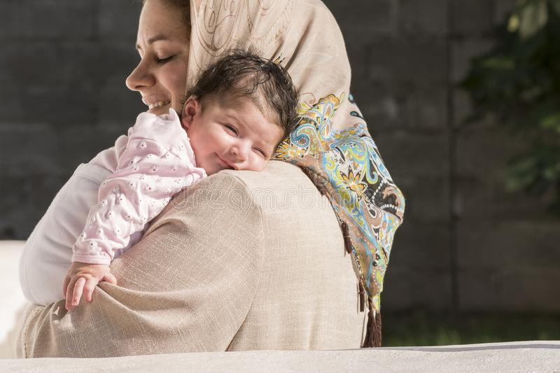 Muslim mother embraced a newborn baby. In outdoor environment royalty free stock images