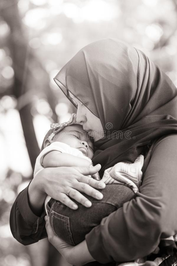 A Muslim Mother Holding Her Baby Daughter Stock Image