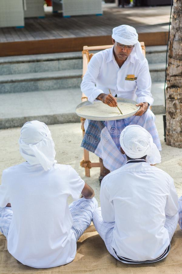 Muslim orthography teacher giving lesson to his students stock photos