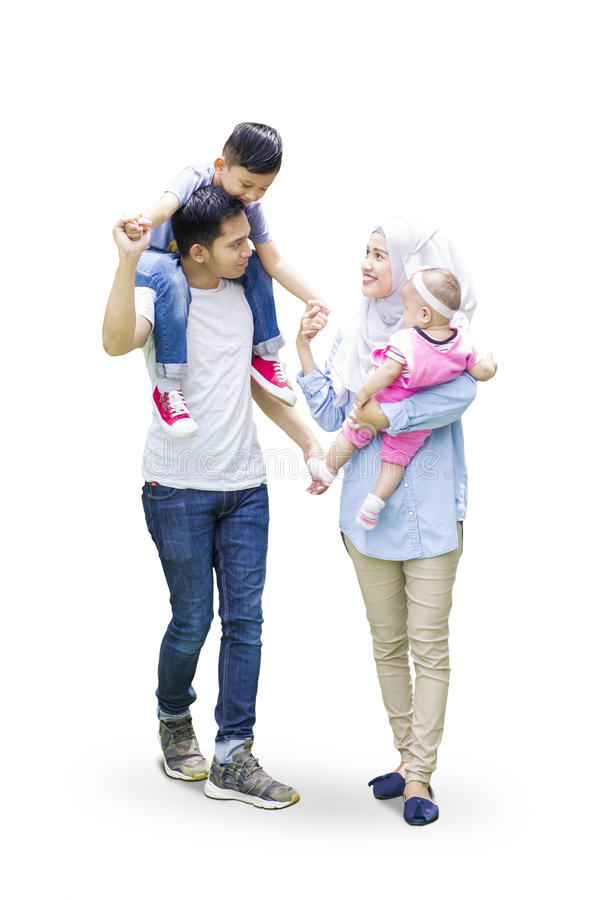 Muslim parents and kids walk in studio stock photography