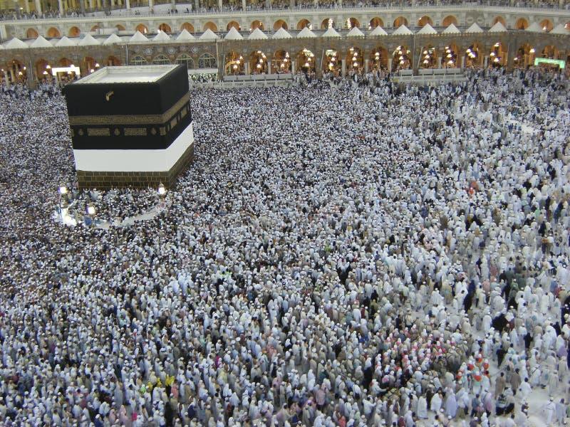 Muslim pilgrims at Al Haram Mosque entrance royalty free stock image