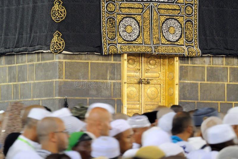 Muslim pilgrims in front of Kaaba in Mecca in Saudi Arabia Editorial. Mecca, Saudi Arabia - September 14, 2016: Muslim pilgrims in motion in front of the door of stock photos