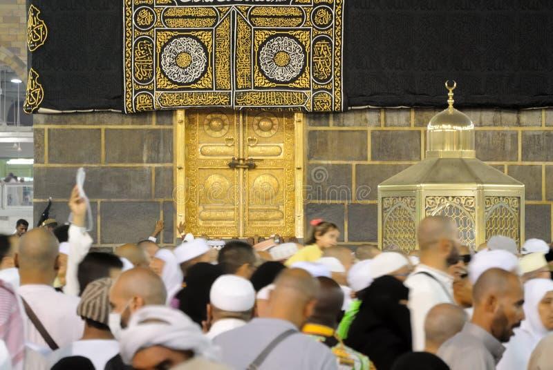 Muslim pilgrims in front of Kaaba in Mecca in Saudi Arabia Editorial. Mecca, Saudi Arabia - September 14, 2016: Muslim pilgrims in motion in front of the door of royalty free stock photos