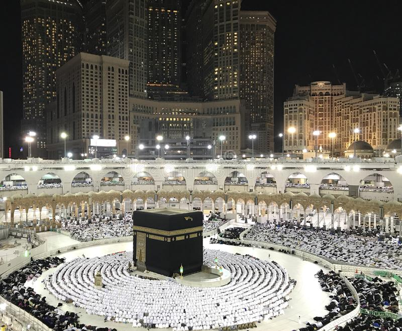 Muslim pilgrims in prostration sujud position facing the Kaabah during evening prayer. Bird`s eye view of unidentified Muslim pilgrims in prostration sujud stock image