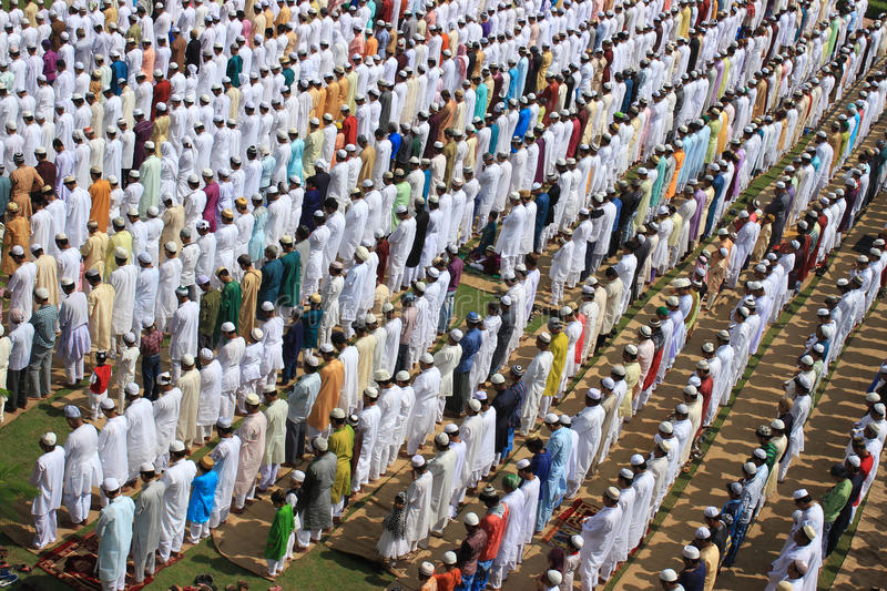 Muslim prayer. A group of Muslim are praying. They weared different color dress.