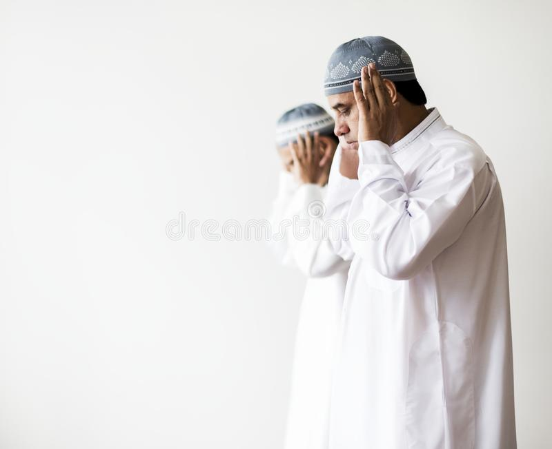 Muslim prayers in Takbiratul-Ihram posture stock images