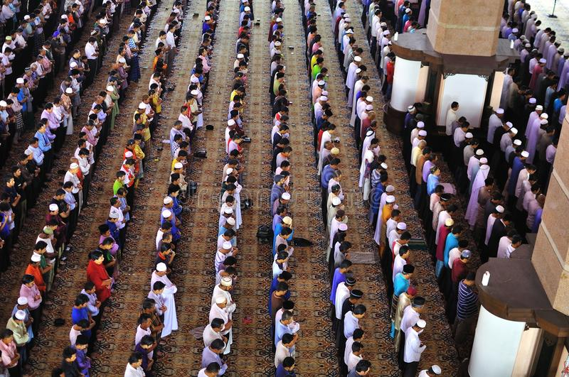 Muslim praying in a mosque stock image