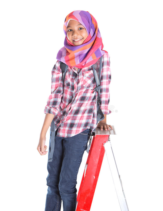 Muslim School Girl And Ladder III stock photos