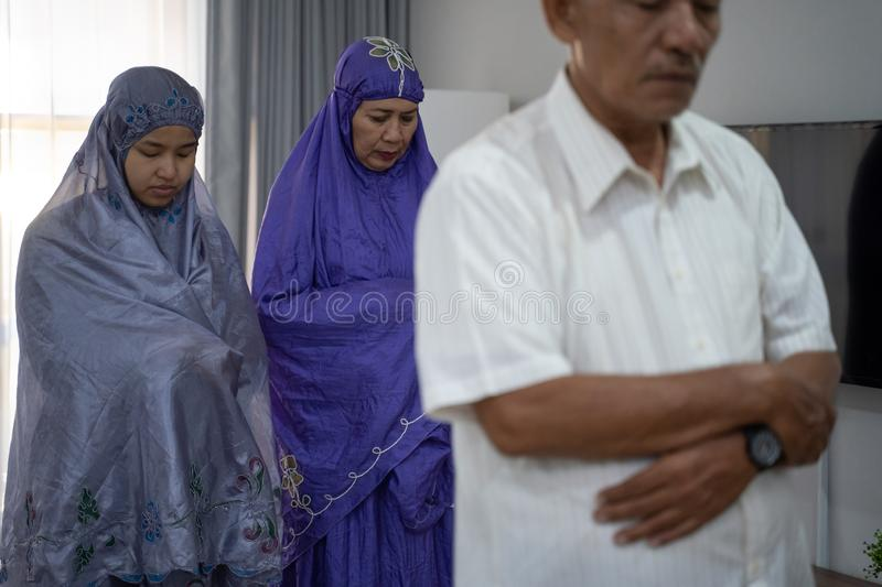 Muslim senior old asian male leading praying in congregation stock photography
