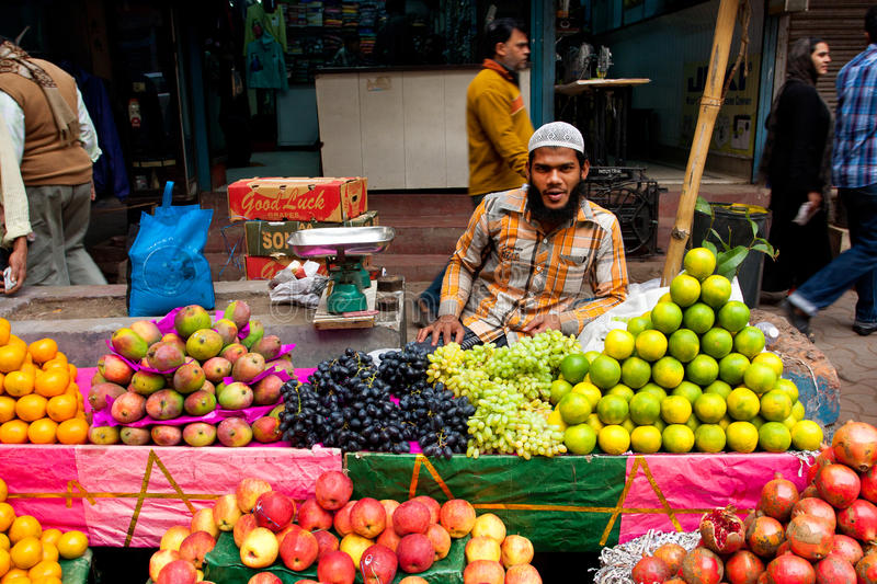 Muslim street trader sell fruits outdoor. In Kolkata India. Only 0.81% of the Kolkata's workforce employed in the primary sector (agriculture royalty free stock photo