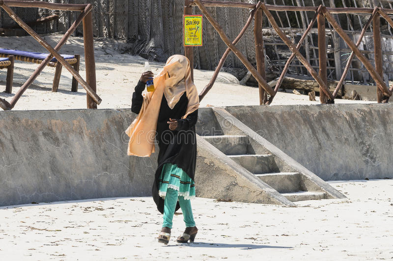 Muslim Woman on the beach stock images