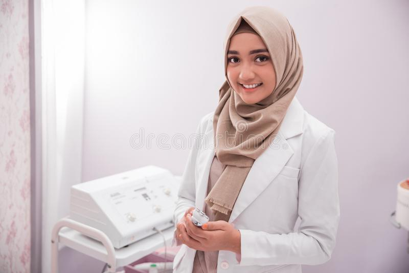 Muslim woman beautician doctor stock images