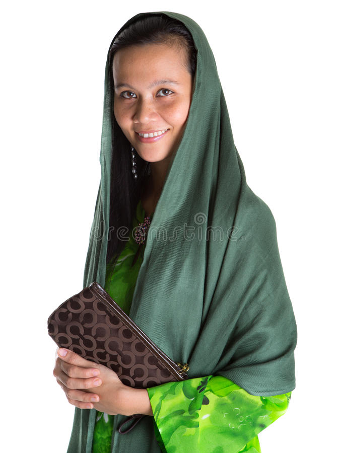 Muslim Woman With A Brown Purse III. Muslim woman with a headscarf and a brown purse over white background stock images