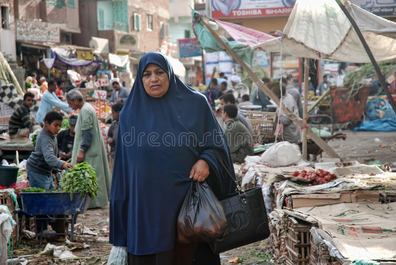 Muslim woman in a burqa. On the market, Hurghada, Egypt stock images