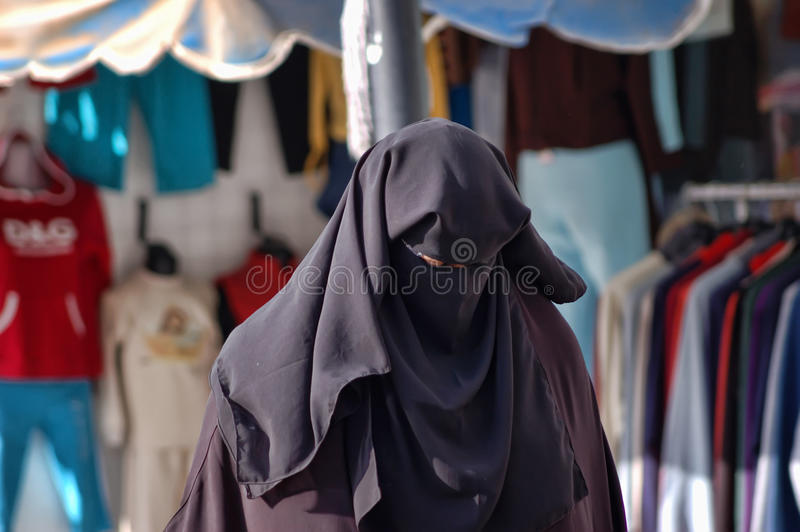 Muslim woman in a burqa royalty free stock image
